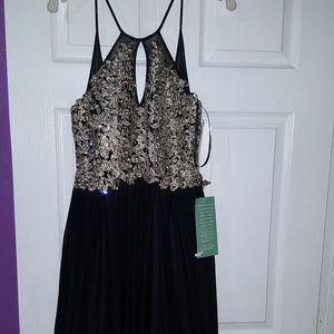 black and gold prom dress .